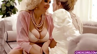 Lesbian MILF surprises her bride dauther with a hot pussy licking session before her wedding day.