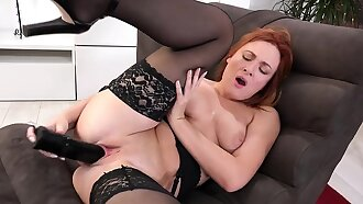 Eva Berger stretches her pussy with a send back and big dildo