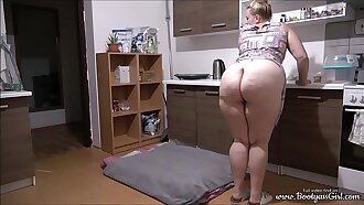 Phat ass girl masturbates with cucumber in kitchen.